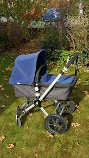 Blauer Bugaboo Cameleon Kinderwagen zu