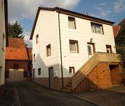 Einfamilienhaus mit Wirtschaftsgebäuden