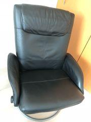 Leder-Sessel und Hocker