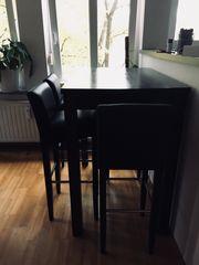 Holztisch mit 4 Leder Hockern