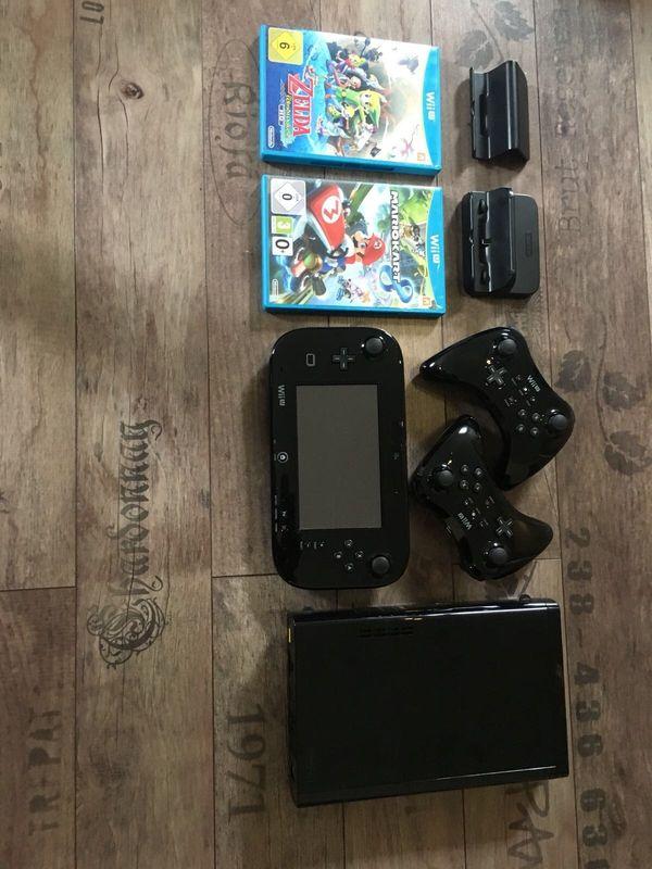 Wii U 32GB + Gamepad + 2 Pro Controller & inkl. Spiele - Gernsheim - Verkaufe meine Wii U mit 32GB Speicher, Gamepad, zwei Wii U Pro Controllern in schwarz, sowie die Spiele Mario Kart 8 (inkl. beide verfügbaren DLC's) und The Legend of Zelda the Windwaker HD.Die Wii U hat leichte Gebrauchsspuren in Form von e - Gernsheim